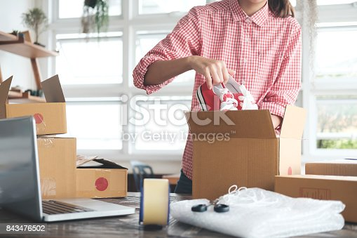 istock Young startup entrepreneur small business owner working at home, packaging and delivery situation. 843476502