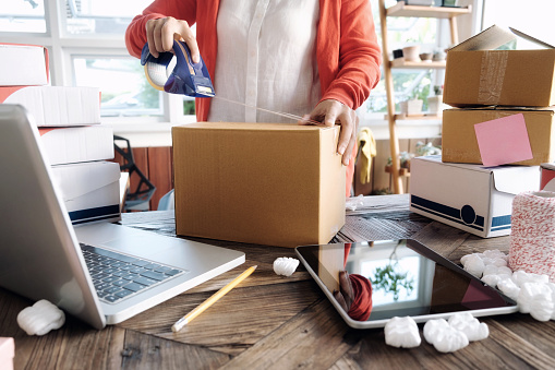 istock Young startup entrepreneur small business owner working at home, packaging and delivery situation. 925332638