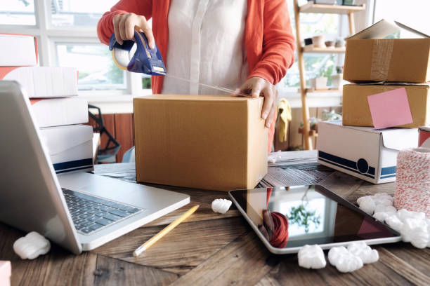 young startup entrepreneur small business owner working at home, packaging and delivery situation. - vendere foto e immagini stock