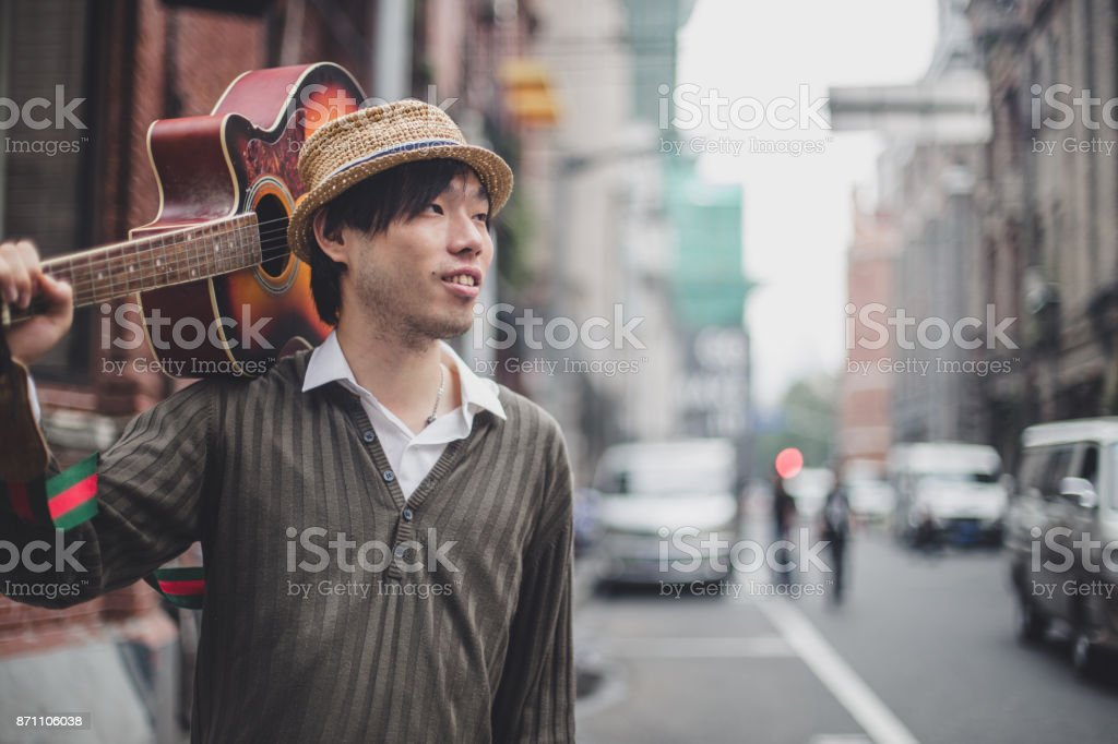 Young street guitar player stock photo