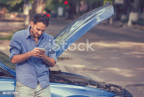 istock young stressed man driver having trouble with his broken car looking in frustration at failed engine 664857828
