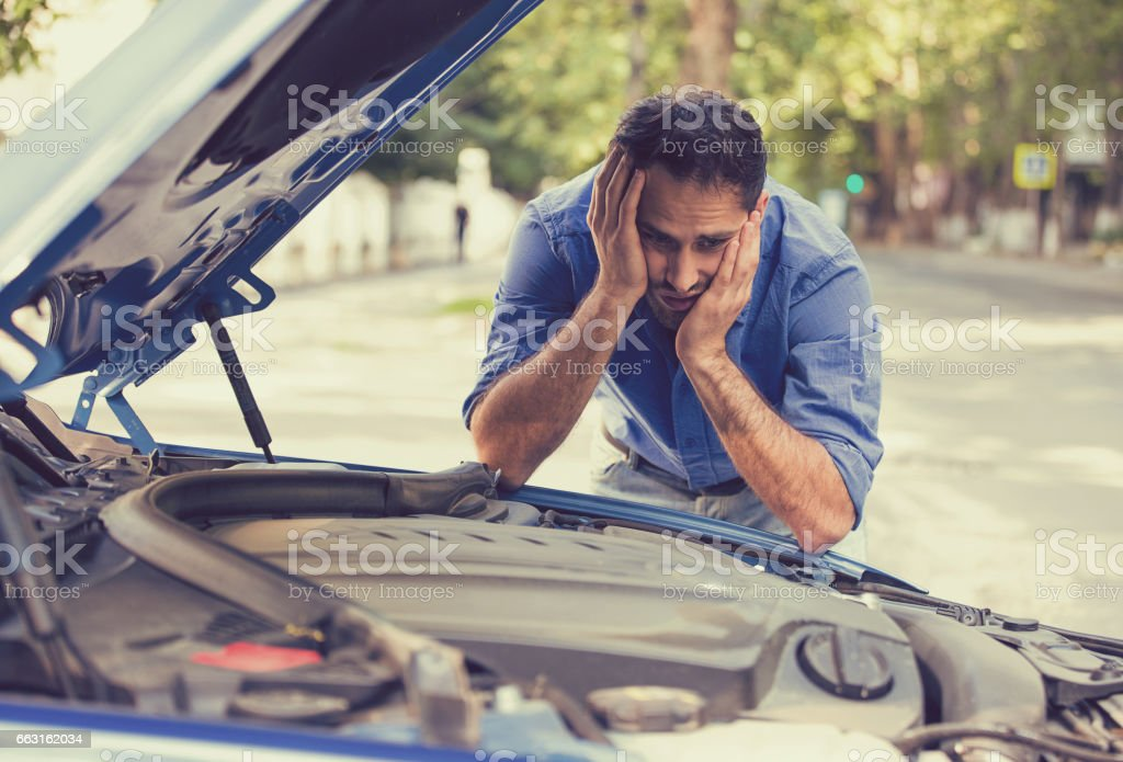 young stressed man having trouble with his broken car stock photo