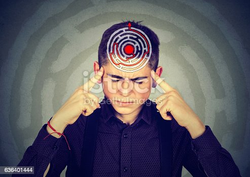 istock Young stressed man solving puzzle 636401444