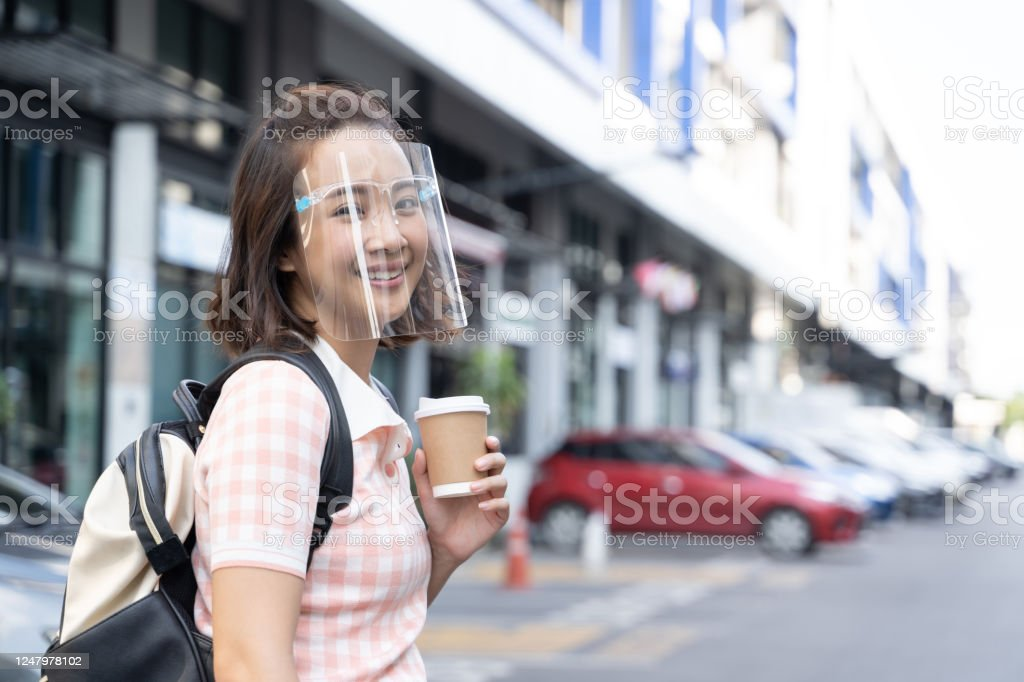 Young student Asian woman wearing mask face shield to prevent virus Young student Asian woman wearing mask face shield to prevent virus Adult Stock Photo