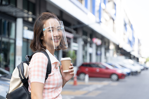 Young Student Asian Woman Wearing Mask Face Shield To Prevent Virus Stock Photo - Download Image Now