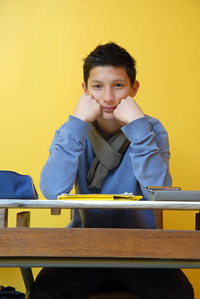 young student behind his desk boy sitting in class behind his desk ecole stock pictures, royalty-free photos & images