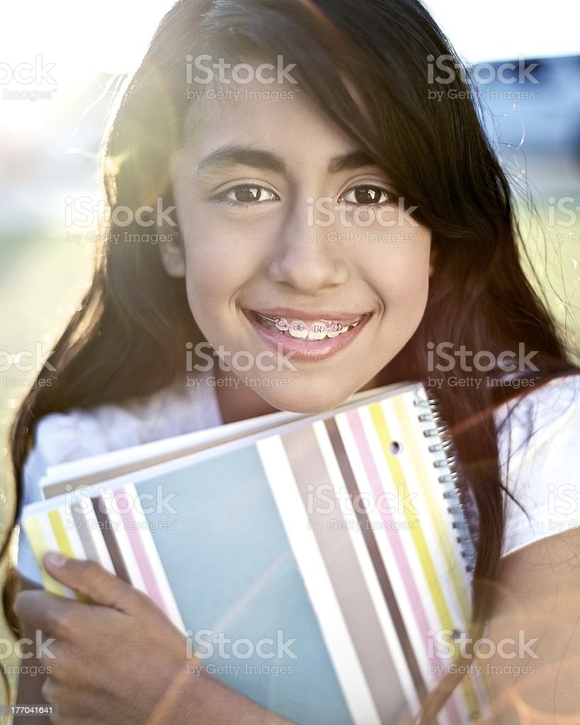 Young student embracing education royalty-free stock photo