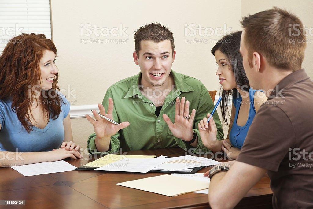 Young Student Explaining Something During Study Group royalty-free stock photo