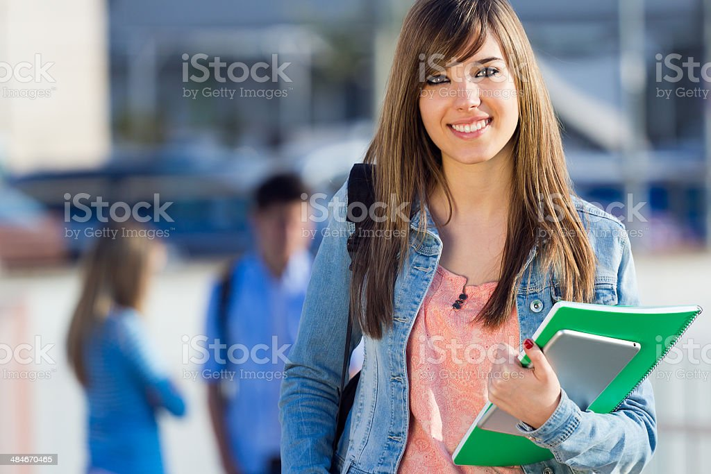 Young student girl looking at the camera stock photo