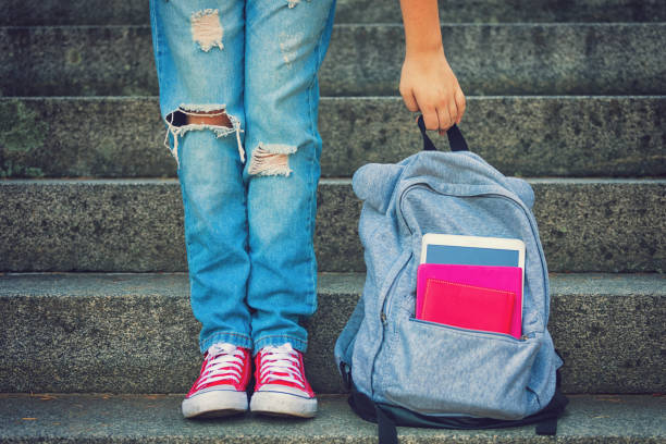young student girl with backpack - back to school stock pictures, royalty-free photos & images