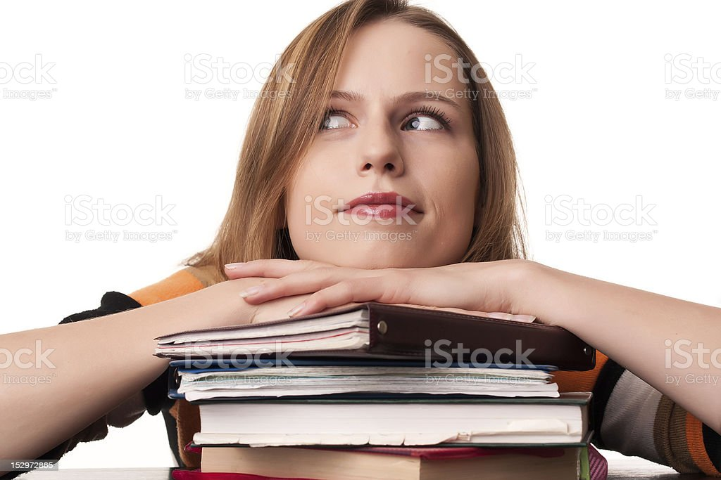 Young student girl with head on top of books pile royalty-free stock photo