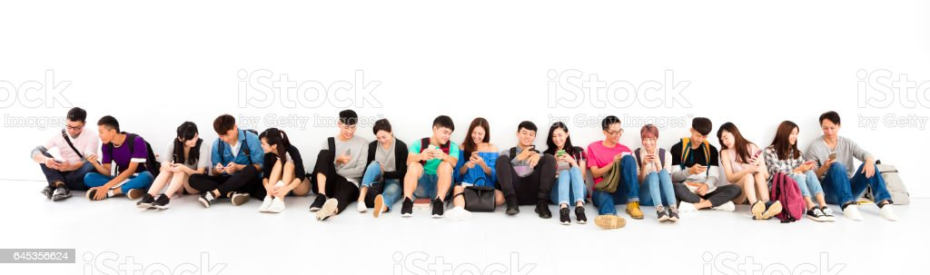 young student Group watching smart phone stock photo