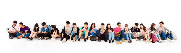 young student group watching smart phone - east asian ethnicity stock photos and pictures