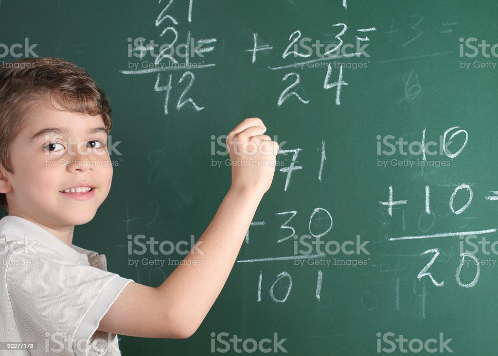 Young Student In Front Of Blackboard royalty-free stock photo