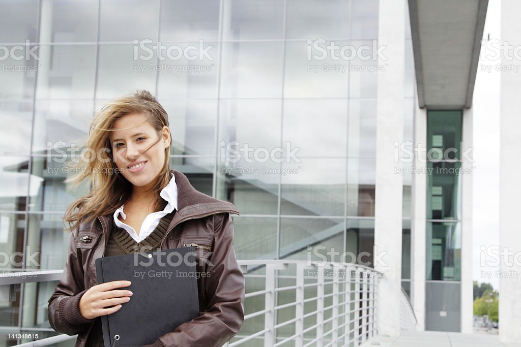 Student or young professional in office park.
