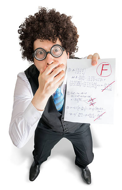 Young student is showing math exam with bad grade F. stock photo
