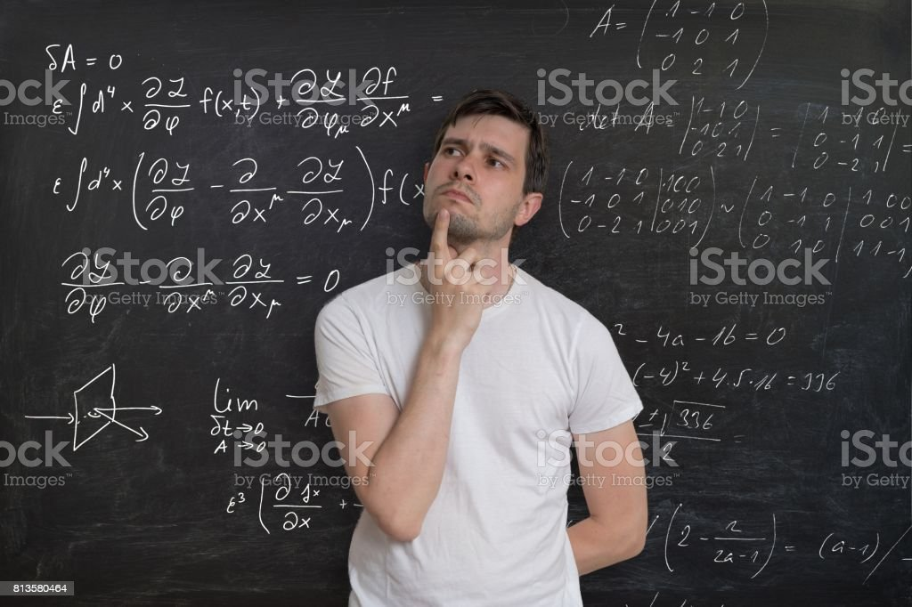 Young Student Is Thinking And Solving Mathematical Problem Math ...