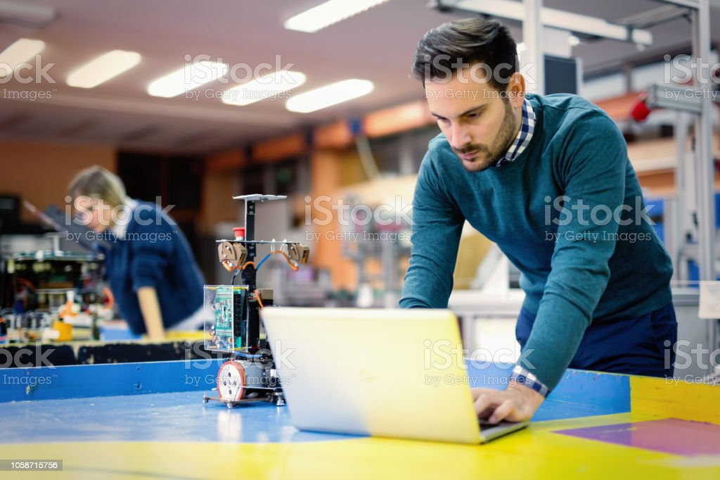 Young student of mechatronics working on project stock photo