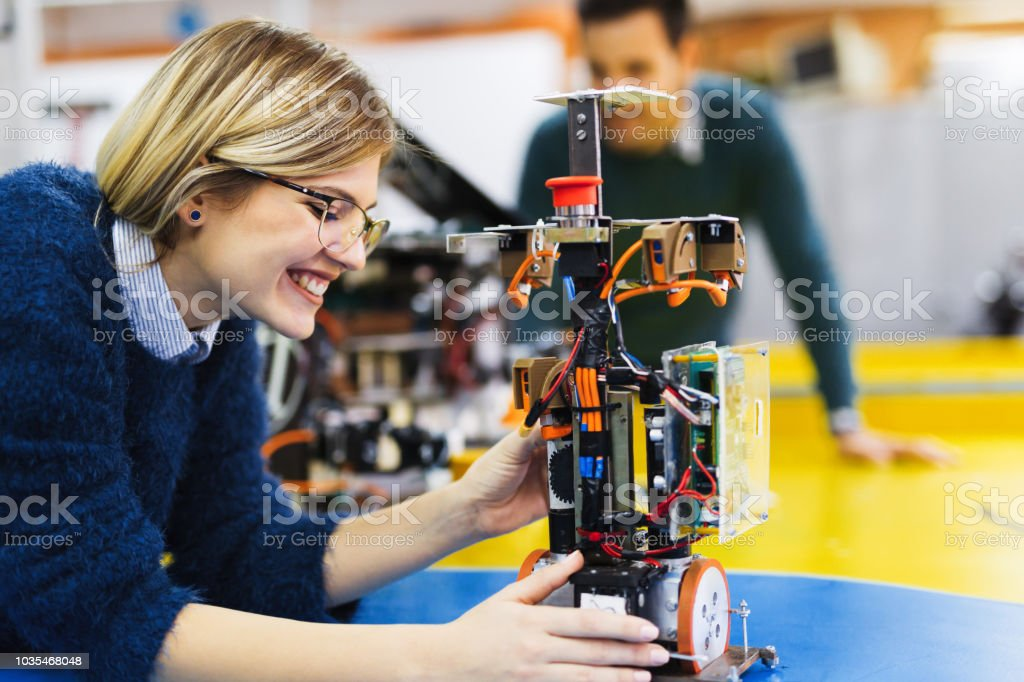 Young student of robotics working on project stock photo