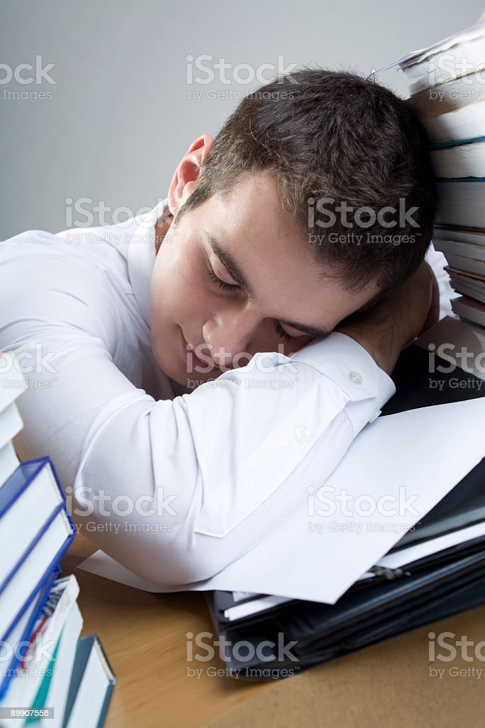 Young student or businessman sleeping at the table royalty-free stock photo