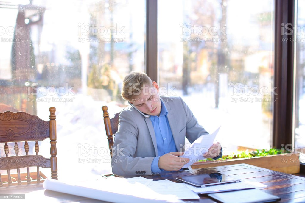 Young student preparing before exam in fast motion at cafe with stock photo