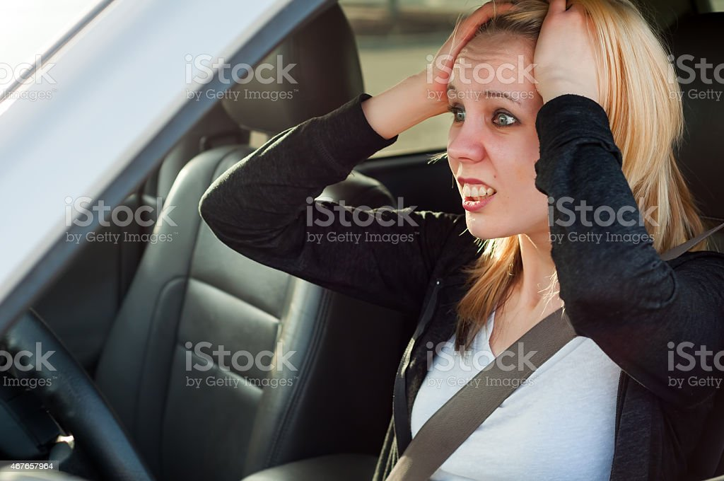 Young student teen panic in a suv car iccedent stock photo