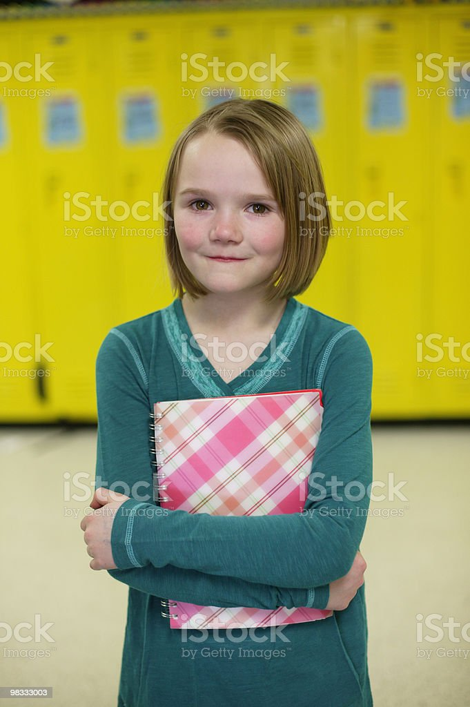 young student with her notebook in hallway of scho foto stock royalty-free