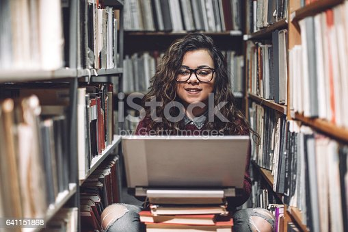 istock Young student woman 641151868