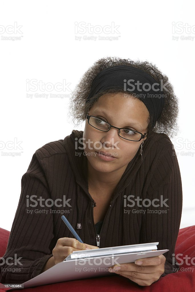 Young student writing on clipboard royalty-free stock photo