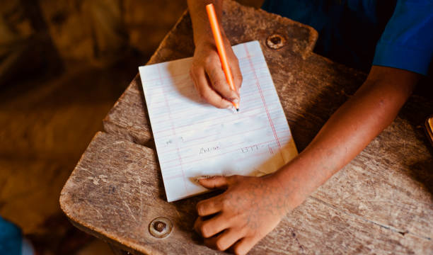 Young student writing with a pen stock photo
