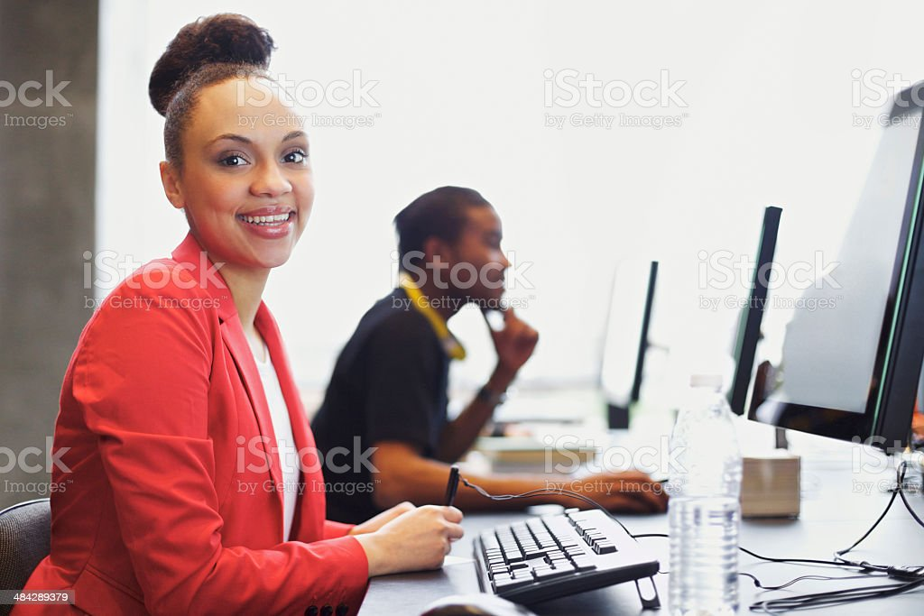Young students at college computer lab stock photo