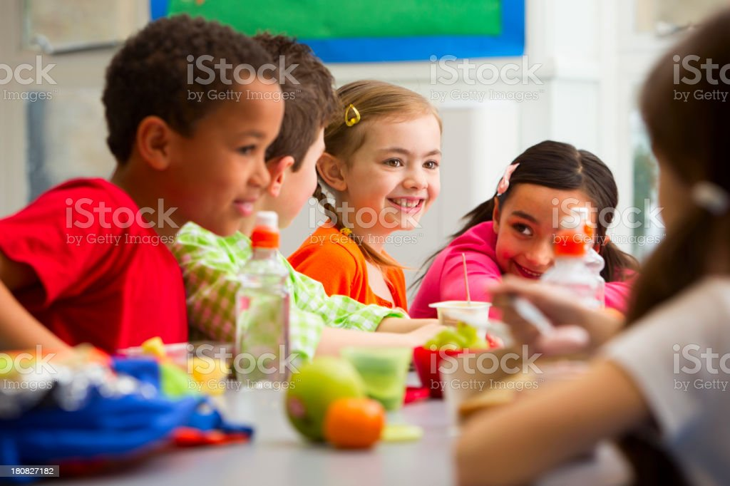 Young Students Enjoying Their Lunch At School Group of children having packed lunches 8-9 Years Stock Photo