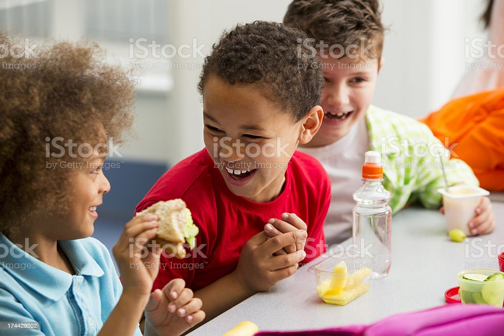 Young Students Finding Lunchtime Funny royalty-free stock photo