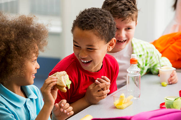 Young Students Finding Lunchtime Funny stock photo