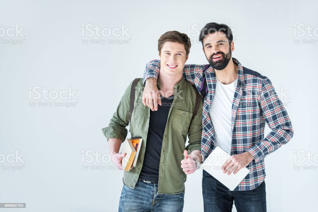 young students holding books on white with copy space stock photo