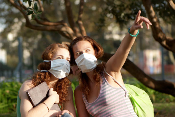 Young students in medical masks stock photo