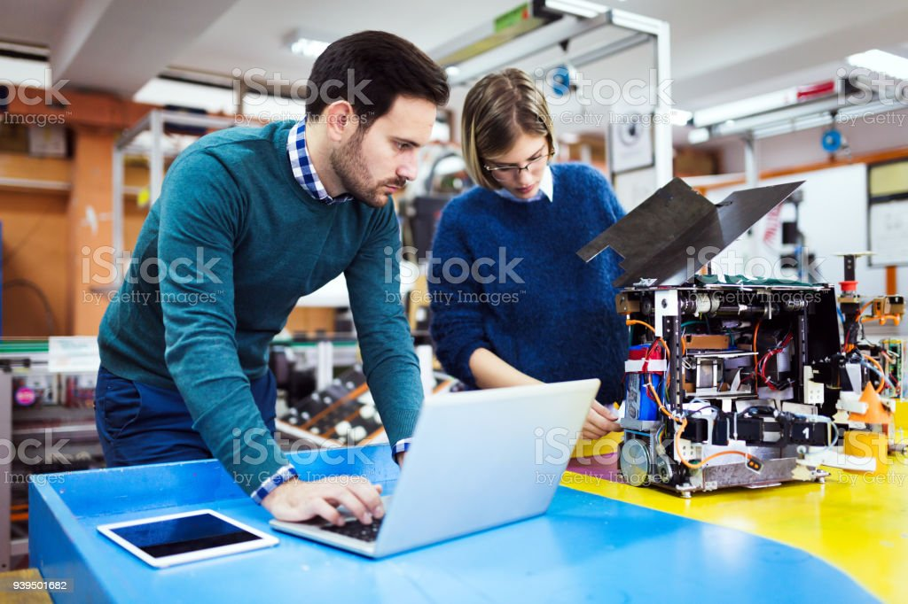 Young students of robotics working on project stock photo