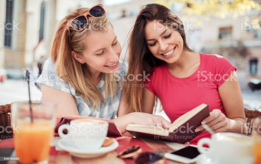 Young students on coffee break in the cafe. Education, lifestyle concept stock photo