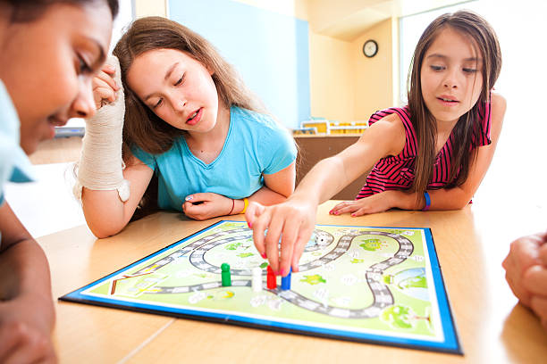 Young students playing an educational game stock photo