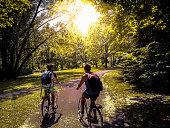 Young students riding their bikes on Rheinaue park, Bonn, Germany