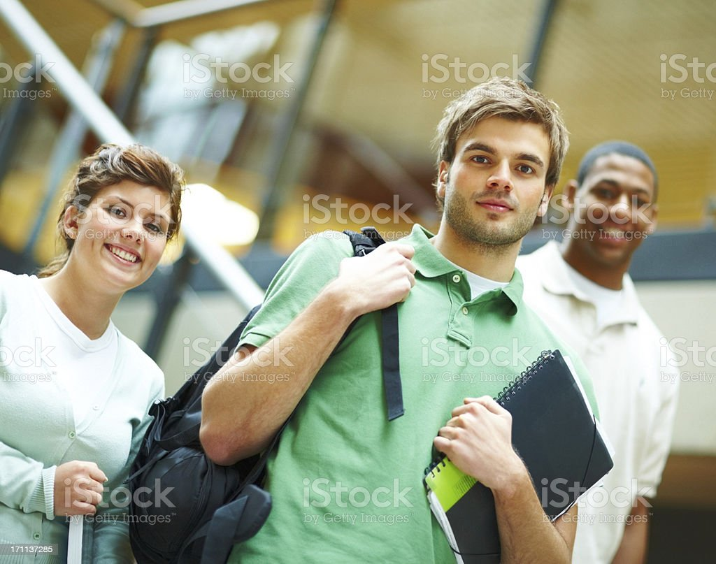 Young students standing together and smiling royalty-free stock photo