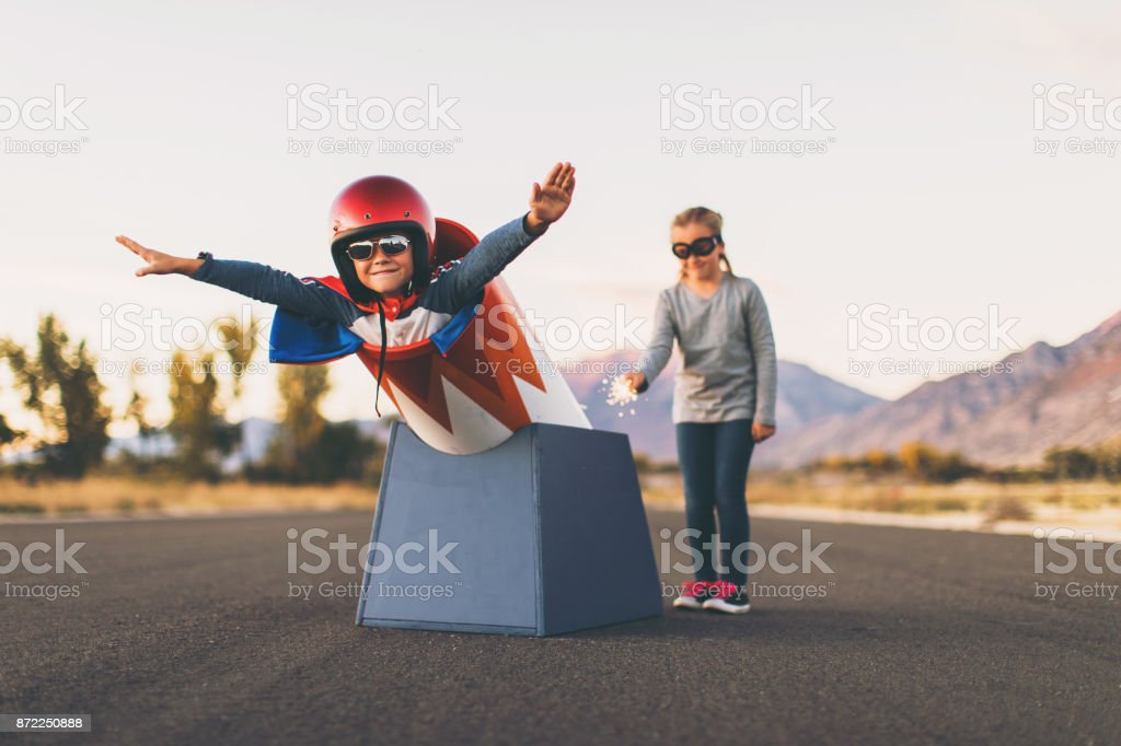 Young Stunt Boy and Human Cannon Ball stock photo