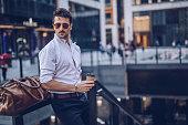 istock Young stylish businessman having takeaway coffee 1080910832