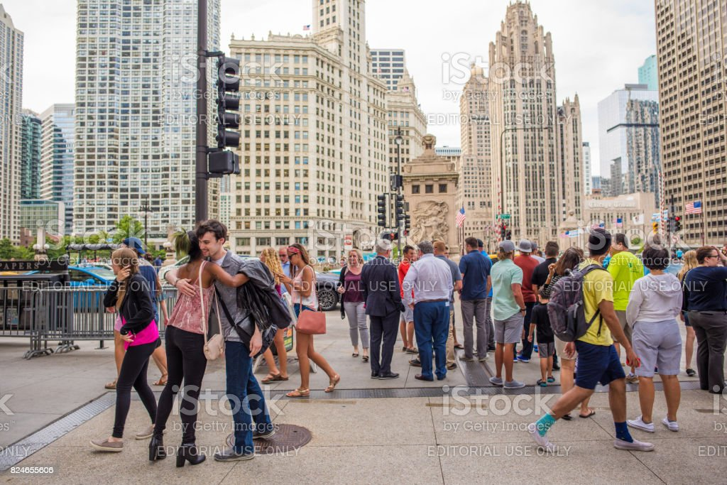 Young, stylish couple hugging, downtown Chicago stock photo