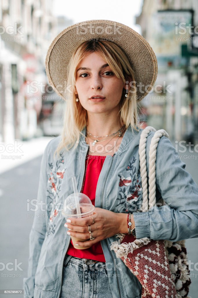 Young stylish woman in the street stock photo