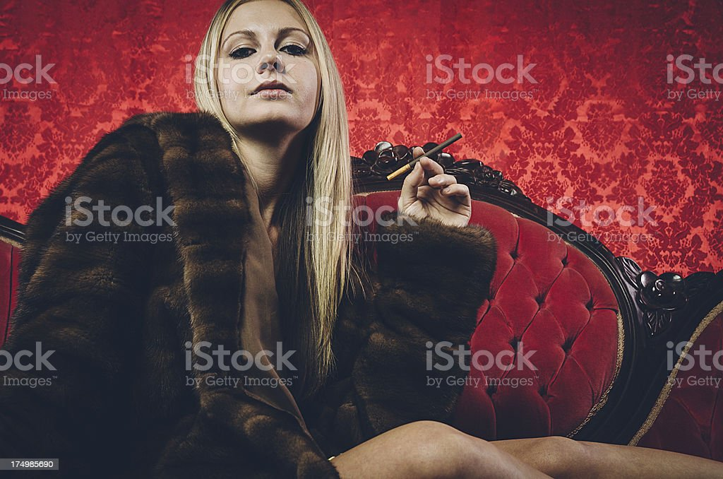 Young stylish woman on antique couch royalty-free stock photo