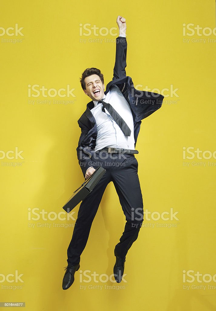 Young succesful businessman in the victory jump stock photo
