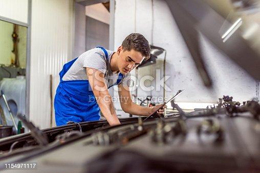 istock Young succesful professional car repairman 1154971117