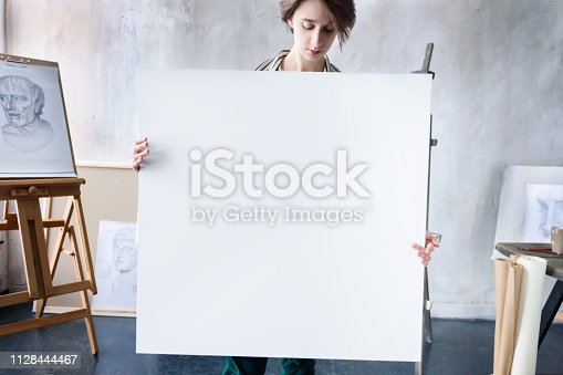 istock Young successful artist in art workshop studio 1128444467