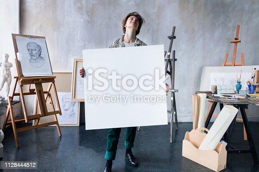 istock Young successful artist in art workshop studio 1128444512